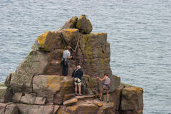 Climbers 2. Climbers at the summit of the 'Old Man of Stoer, Scottish Highlands royalty free stock image