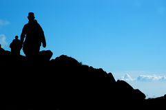 Climbers. Silhouette of a climbers on blue background Royalty Free Stock Image