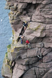 Climbers. Four climbers ascending the 'Old Man of Stoer', Scottish Highlands stock image