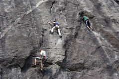 Climbers. Three climbers at Melloblocco meeting. This is a international meeting that has attracted thousands of boulders from all over the world for the most Stock Photo