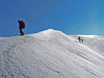 Climbers. Mountain. Five climbers go to the mountains. The snow, glacier Stock Photography