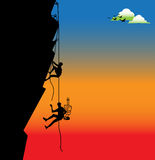 Climbers. Abstract colorful illustration with birds, clouds, and two climbers hanging on ropes and trying to climb a difficult side of a rock Stock Photography