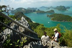 Climbers above the sea. Climbing in a natural park in Thailand royalty free stock image