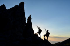 Climbers accessing pointy rocks. Mountaineering ; climbers accessing pointy rocks royalty free stock image