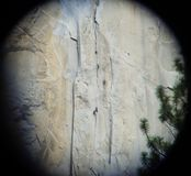 Climbers Ascend El Capitan in Yosemite Through Binoculars Royalty Free Stock Photography