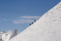 Climbers ascend the hill. A group of alpinists climbs Mont Blanc in France royalty free stock image