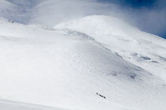 Climbers ascend the mountain. Top royalty free stock photo