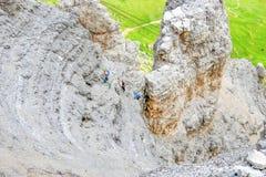 Climbers ascending Sass Pordoi mountain massif, Dolomites Alps, Italy. Climbers ascending Sass Pordoi mountain massif, Dolomites Alps, Italy, Europe Stock Photos
