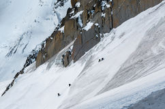Climbers ascending way up to Aiguille du Midi with details  Stock Photo