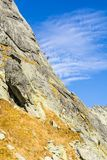 Climbers on a belay stance on the wall slabs on a beautiful sunny autumn day. royalty free stock images