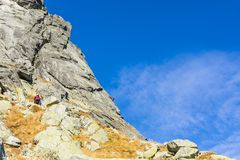Climbers on belay stance on the wall slabs, while climbing in the Tatras. Mala Szarpana Turnia Maly Osarpanec. royalty free stock images