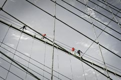Climbers on the Brooklyn bridge cables, New York City USA. Climbers on the Brooklyn bridge cables, New York City, USA stock photo