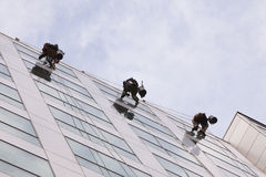 Climbers clean the windows Stock Images