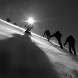 Climbers climbing the glacier. Silhouettes of climbers climbing the glacier royalty free stock photography