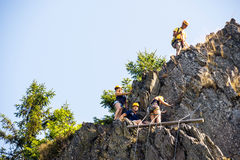 Climbers Climbing On Rock. Low angle view of climbers climbing on rock Stock Images