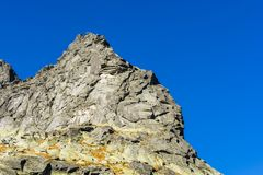 Climbers while climbing in the Tatra mountains on a climbing route called Plskova Cesta Droga Plska and evaluate the difficultie stock images