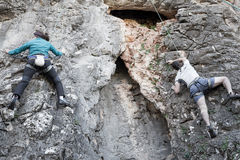 Climbers couple climbing rock cliff. Stock Photography