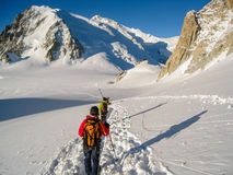 Climbers crossing the Col du Midi glacier in fresh snow making t Royalty Free Stock Image