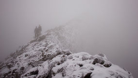 Climbers Descending a Mountain in the Fog Royalty Free Stock Photography