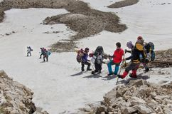 Climbers descending from mountain summit Royalty Free Stock Photo
