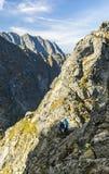 Climbers in an easy mountain area are preparing for climbing. stock photos