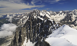 Climbers on French Alps viewed from Aiguille du Midi, France Royalty Free Stock Photography