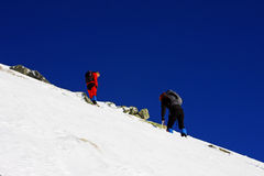 Climbers going up the mountain in Retezat mountains, Romania Stock Photos