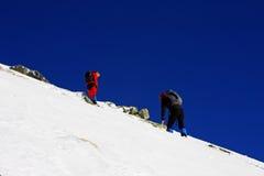 Climbers going up the mountain in Retezat mountains, Romania Stock Photos