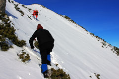 Climbers going up the mountain in Retezat mountains, Romania Royalty Free Stock Image