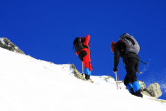 Climbers going up the mountain in Retezat mountains, Romania. This image presents two young climbers climbing up the mountains in Retezat mountains, Romania Royalty Free Stock Photography