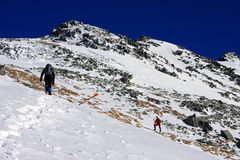 Climbers going up the mountain in Retezat mountains, Romania. This image presents two young climbers climbing up the mountains in Retezat mountains, Romania Royalty Free Stock Images
