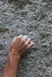 Climbers hand on granite Stock Photography