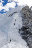 Climbers heading up to Camp 2 on Cho Oyu. Climbers starting the long climb up to Camp 2 from Camp 1 Stock Photography