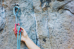 Climbers hold and quick-draw Royalty Free Stock Photography