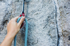 Climbers hold and quick-draw Stock Photo
