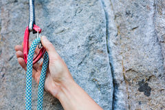 Climbers hold and quick-draw Stock Images