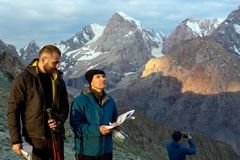 Climbers learning future route of ascent Royalty Free Stock Photos