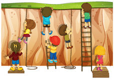 Climbers. Many children climbing up the cliff and ladder Stock Image