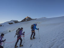 Climbers on Monte Rosa behind Lyskamm peak, Monte Rosa, Alps, It Stock Image