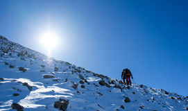 Climbers at the mountain summit in scenic Tian Shan range Stock Photo