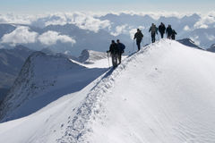 Climbers in the mountains. Climbers on a snow edge Stock Images