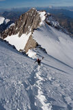 Climbers at mountains. Climbers reaching the summit at Alps Royalty Free Stock Images