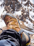Climbers at the mountains. Boot of climber sportsmen hiking to the mountain peak Stock Photo