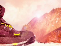 Climbers at the mountains. Boot of climber sportsmen hiking to the mountain peak Stock Photos
