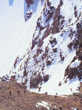Climbers at the mountains. Group of climbers sportsmen hiking to the mountain peak Royalty Free Stock Photos