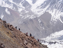 Climbers at the mountains. Group of climbers sportsmen hiking to the mountain peak Stock Photos