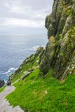 Wild Atlantic Way Ireland: Physically exhausted, spiritually replenished pilgrim soulmates near end of Skellig Michael staircase. royalty free stock photography
