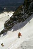Climbers On Steep Snow Royalty Free Stock Photos