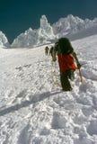 Climbers On Steep Snow Royalty Free Stock Image