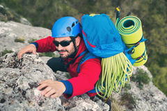 Climbers reaches the top of mountain peak Royalty Free Stock Photos